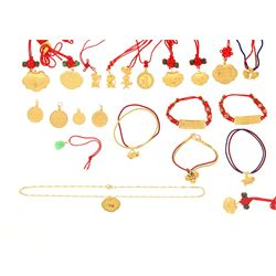 PENDANTS: [22] Various 22k yellow gold pendants and charms strung on cord; 94.1 grams.