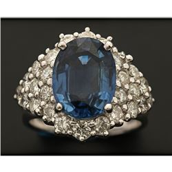 RING: 18k white gold ring, size 5; (1) oval mixed cut blue sapphire, 11.34mm x 8.43mm x 4.58mm = an