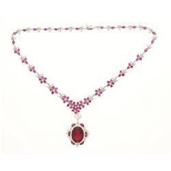 NECKLACE: [1] 18k white gold necklace, 18 inches long; (1) oval mixed cut imitation red stone, 20mm