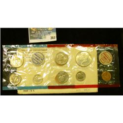 1969 U.S. Mint Set in original envelope and cellophane as issued. Includes Silver Half Dollar.