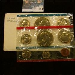 1044 _ 1975 P & D U.S. Mint Set in original government holder as issued. With scarce Type One Dollar