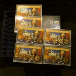 1168 _ Six plastic cases with Presidential Dollars in a storage box. (11 BU Dollar Coins included).