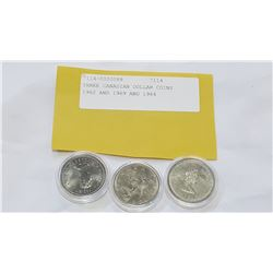 THREE CANADIAN DOLLAR COINS 1982 AND 1969 AND 1984