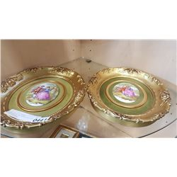 PAIR OF GILT FRAMED HANDPAINTED ON PORCELAIN LOVE STORY PICTURES