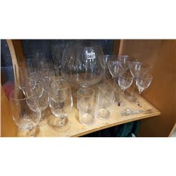 SHELF LOT OF GLASSES AND LARGE GLASS VASE
