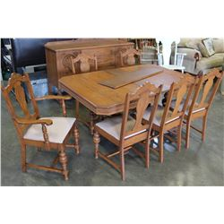 CARVED OAK DINING TABLE WITH 2 LEAFS AND 6 CHAIRS