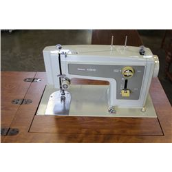 KENMORE SEWING MACHINE TABLE W/ ACCESSORIES