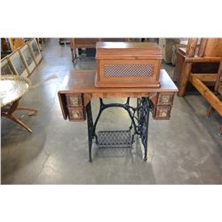 ANTIQUE SINGER SEWING MACHINE ON TABLE WITH TREADLE BASE