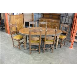 CARVED ANTIQUE CRANK DINGING TABLE W/ CRANK AND 2 LEAFS W/ 6 CHAIRS