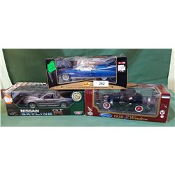 THREE DIE CAST CARS IN BOXES
