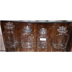 FOUR GLASS CANNISTER JARS