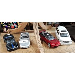 FOUR COLLECTIBLE DIE CAST CARS