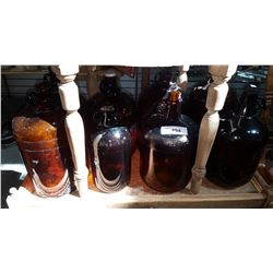 EIGHT VINTAGE BROWN GLASS JUGS