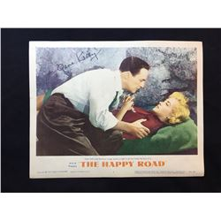 """1957 """"THE HAPPY ROAD"""" LOBBY SCENE CARD, #7 IN SET, SIGNED BY GENE KELLY"""