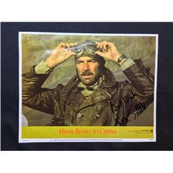"""1983 """"HIGH ROAD TO CHINA"""" LOBBY SCENE CARD, #5 IN SET, SIGNED BY TOM SELLECK"""