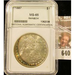 1887 Morgan Silver Dollar Slabbed And Graded Ms 65 Rainbow Toning.  This Books For $185