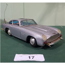 VINTAGE JAMES BOND 007 ASTON MARTIN DBS BATTERY POWERED TIN TOY