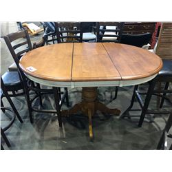 ROUND WOODEN DINING TABLE WITH LEAF