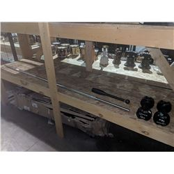 SHELF INCLUDING TWO 12LB DUMB BELLS, WEIGHT BAR AND MORE