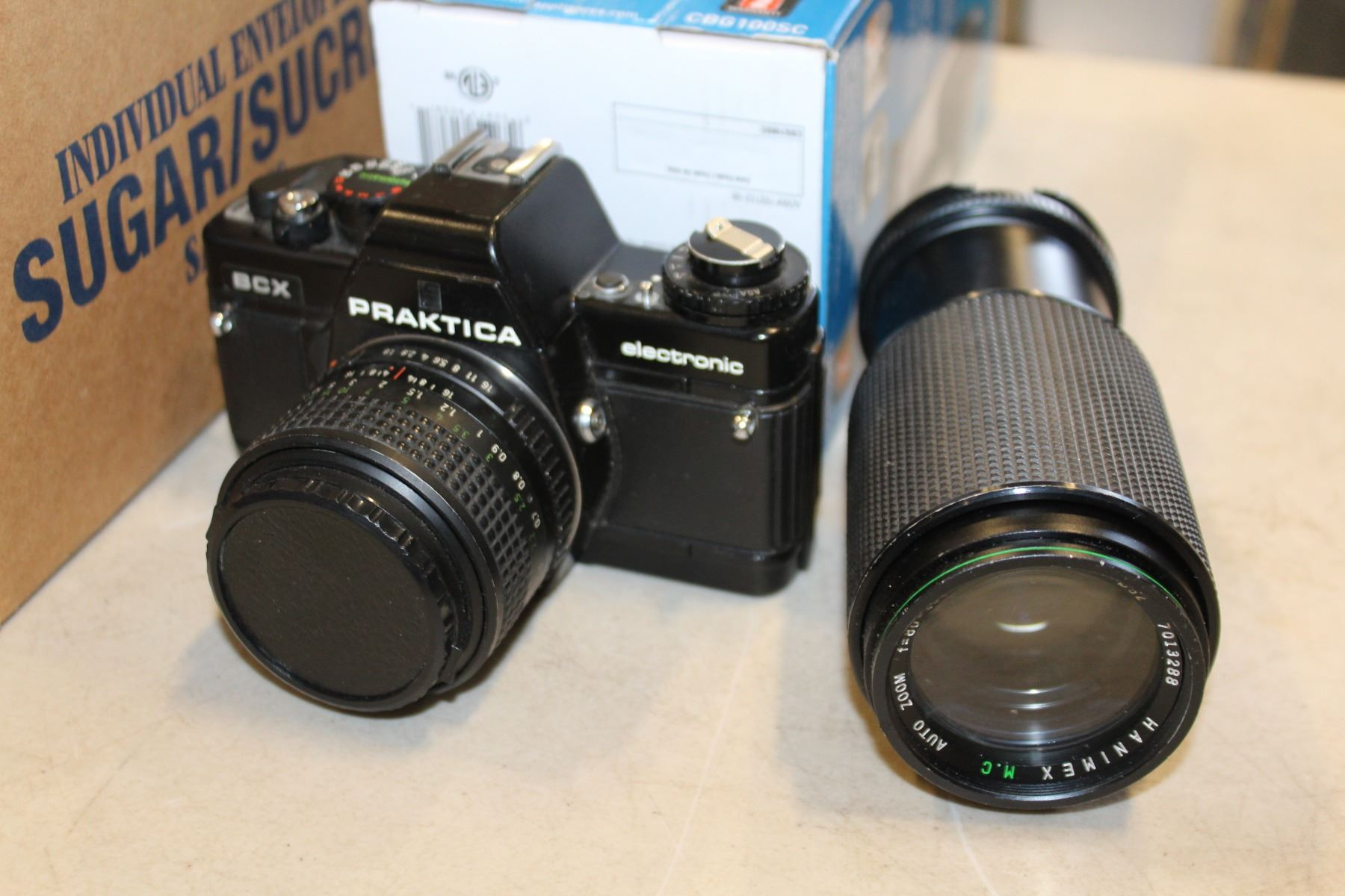 Box with praktica camera and lense panasonic phone system new coffee