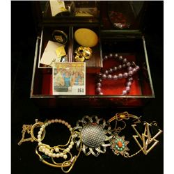 Mirrored Plastic Jewelry Box with swirled wood design containing a variety of old Costume Jewelry.
