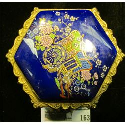 Enameled Jewelry Box with Carriage design with an interesting assortment of costume Jewelry.