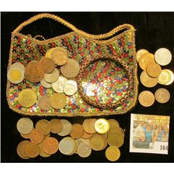 An interesting Sequined Zippered Purse with a bracelet & a variety of Foreign Coins.