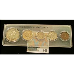 1934 Year Set of U.S. Coins Cent to half dollar in a Snaptight case.