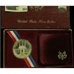 1984 S Olympics Proof Commemorative Silver Dollar in original box of issue.