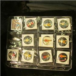 1457 _ 12-Pocket plastic page containing 10 various Sports related Cracker Jacks toys. Doc valued th