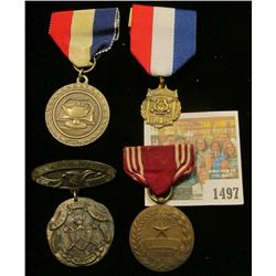 1497 _ Group of Four medals dating back to 1909 and including both an Ottumwa Medal and military ser