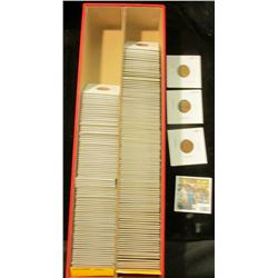 """1503 _ Red 14"""" Double Row Stock Box 3/4 full of carded, ready for Flea Market 1957-up Lincoln Cents."""