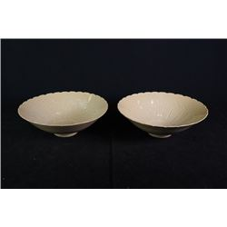 "A Group of Two Large ""Fish"" Bowls Engraved with Flora"