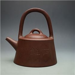 "A Fine Loop-Handled Yixing Teapot with Side Mark of ""Lan Fang Mei, Dong Xi Ke"""
