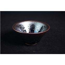 A contemporary bowl with mark and certification.