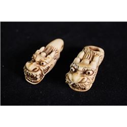 "A pair of ""Dragon"" ivory buckle."