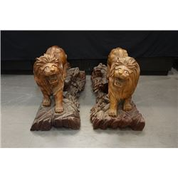 A pair of Early 20th Century Wood Carved lions.