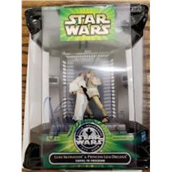 Autographed Luke and Leia Action Figures