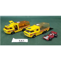 2 VINTAGE MATCHBOX K-7 RACING TRANSPORTER TRUCKS W/CAR