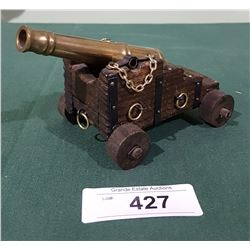 BRASS CANNON ON WOOD STAND
