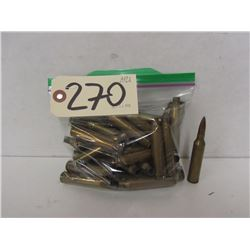 37 PIECES OF 7MM REM MAG BRASS AND ONE LIVE ROUND