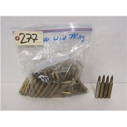 1.4KG OF 300 WIN MAG BRASS AND FOUR LIVE ROUNDS