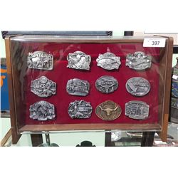 COLLECTION OF 12 LTD ED PEWTER AND BRASS COMMEMORATIVE MONTANA BELT BUCKLES IN DISPLAY CASE