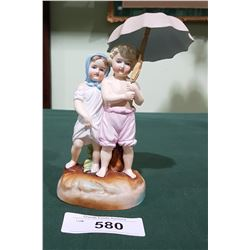 ANTIQUE PORCELAIN FIGURINE