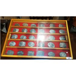 COLLECTION OF 30 HESSTON NATIONAL FINALS RODEO COMMEMORATIVE BELT BUCKLES IN DISPLAY CASE