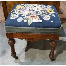 ANTIQUE FOOT STOOL W/EMBROIDERED SEAT ON ORIGINAL WOOD CASTERS