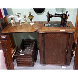 ANTIQUE ENGLISH TREADLE SEWING MACHINE IN CABINET