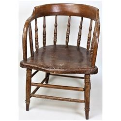 Antique wood saloon chair.