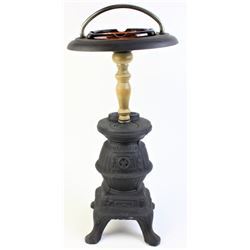 Pot belly stove floor ashtray with glass insert.