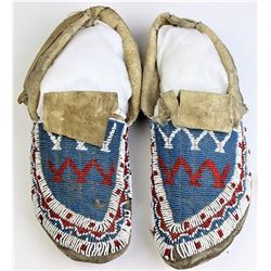 """Fully beaded uppers Sioux moccasins, 11"""" long."""